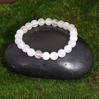 Pale Rose Quartz Healing Bracelet on Black Rock