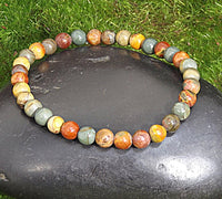 Small Cherry Creek Jasper Healing Bracelet on Black Rock