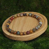 Small Cherry Creek Jasper Healing Bracelet on Wood