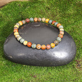 Small Cherry Creek Jasper Healing Bracelet on Black Rock 2