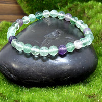 Fluorite Healing Bracelet on Black Rock