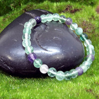 Fluorite Healing Bracelet on Black Rock angled
