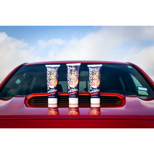 3 Bottles of New Solutionz Auto Pork Wax On Orange Toyota Truck Hood