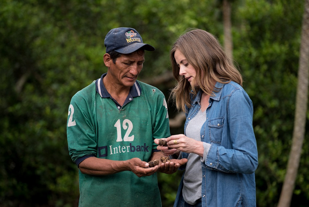 Grower with Nunaia Founder examining the quality of ingredients in the Peruvian Rain-forest for the organic skincare serum
