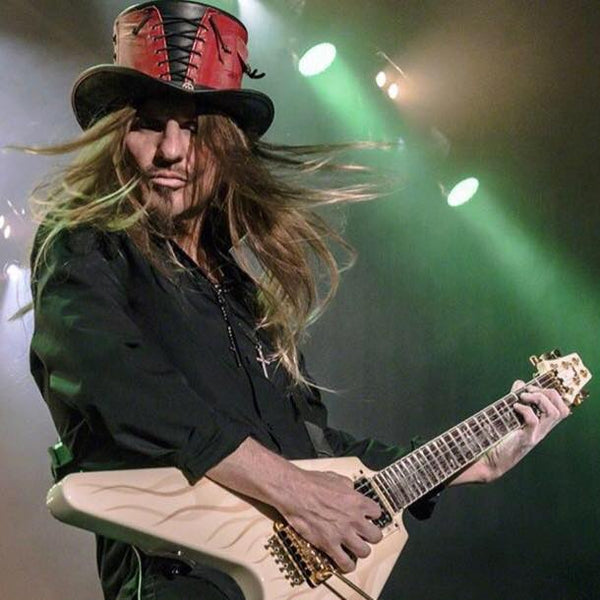 cc deville wearing his limited edition red vested hat playing guitar on stage