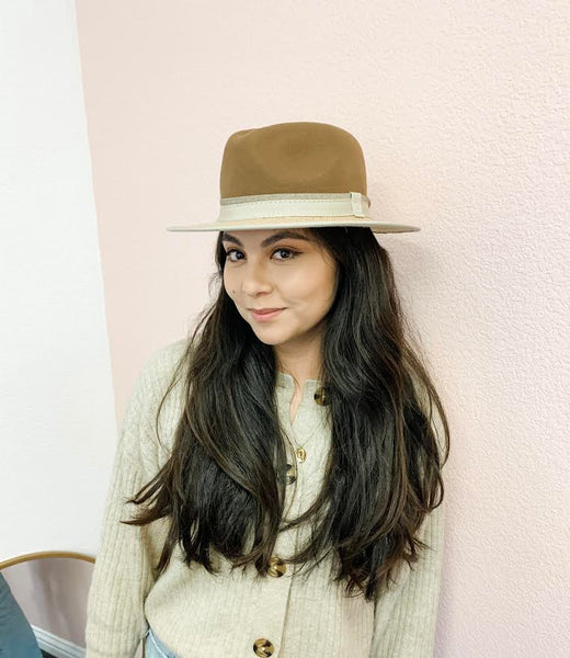 leslie wearing her limited edition hat