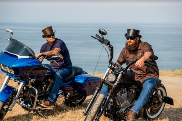 motorbike riders wearing their top hats by the beach