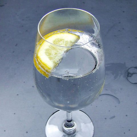 Clear Homebrewed Hard Seltzer with Lemon