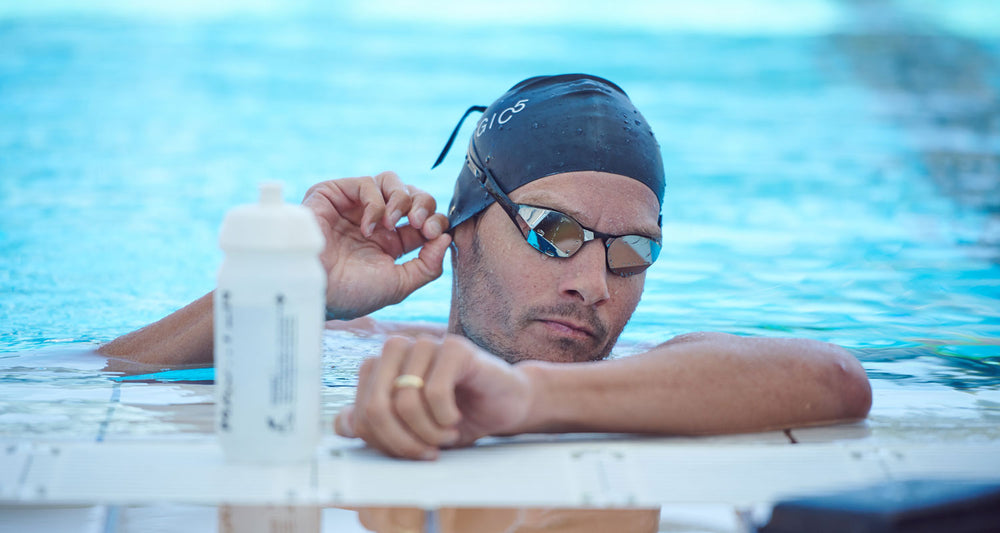 Jan Frodeno adjusting swim cap in the pool