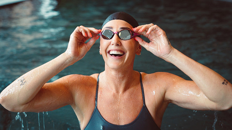 Jeanette Ottesen smiling adjusting THEMAGIC5 goggles