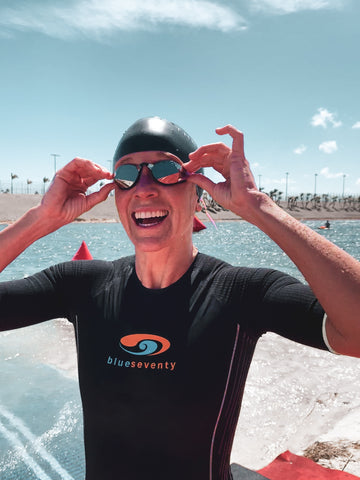 Lesley Smith smiling with her THEMAGIC5 swim goggles
