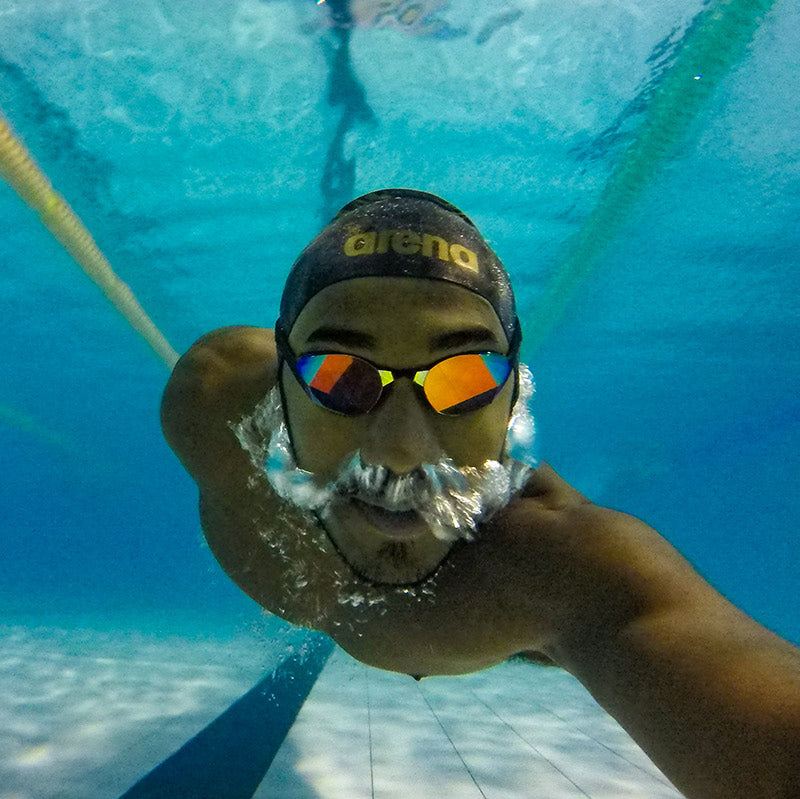 Swimmer wearing THEMAGIC5 Goggles
