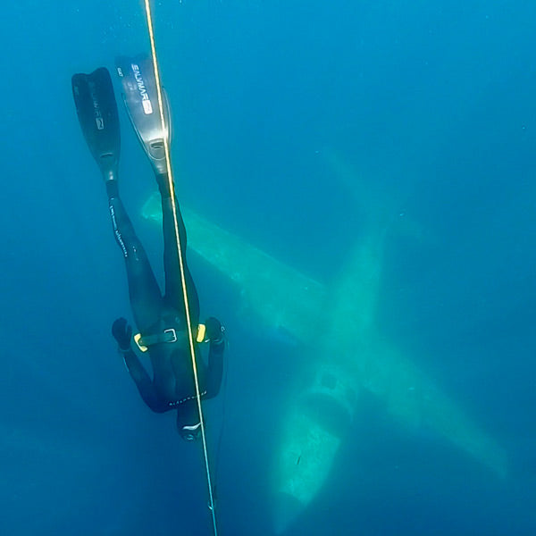 Free-diving next to a sunken airplane.