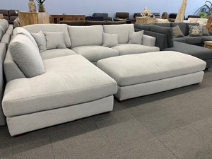 Plush Beige Sectional with Ottoman