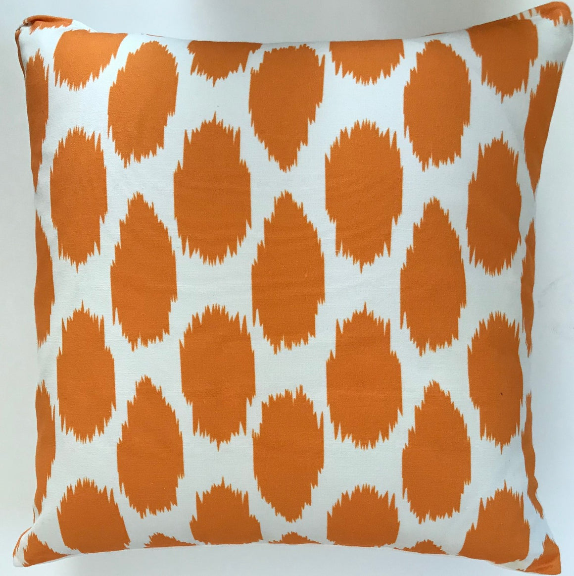 OC29 Cheeky Ikat Print Tangerine organic cotton pillow cover