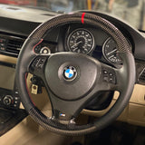 bmw-m-sport-carbon-fibre-steering-wheel-on-car-preview