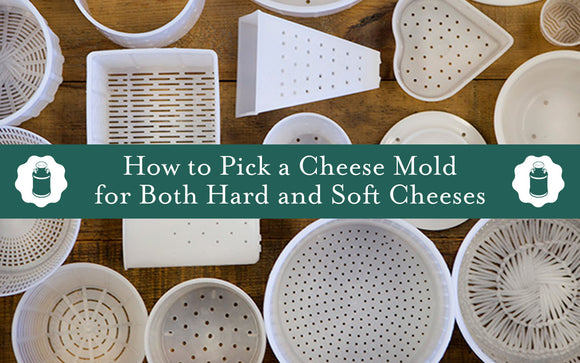 Several cheese molds on a wooden surface with a green banner that says,