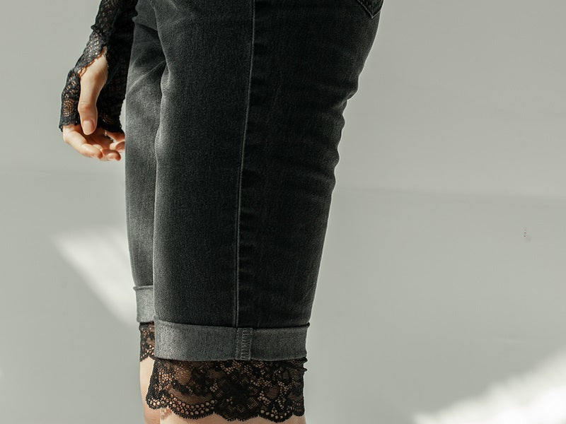 Woman wearing jeans with lace edge