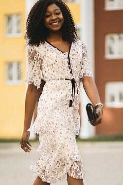 Woman in white lace dress