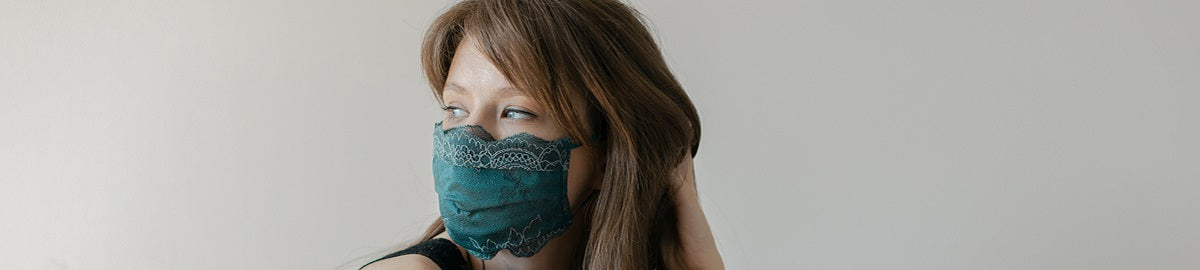 Woman in green lace mask