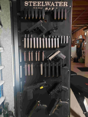 Gun safe with many magazine mounts and handgun mounts that are visible and Spartan Mounts