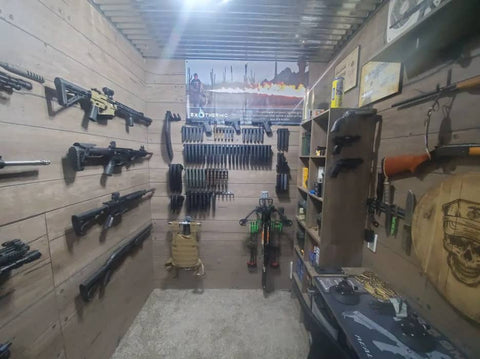 Picture of gun room with a large variety of Spartan Mounts products, including rifle mounts, handgun mounts, magazine mounts, shotgun mounts, and other firearm (and firearm accessory) mounts