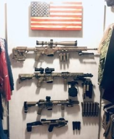 Picture of Spartan Mounts holding up rifles and handguns and magazines. American flag at the top. Picture showcases Spartan Mounts rifle mounts, handgun mounts, and magazine mounts