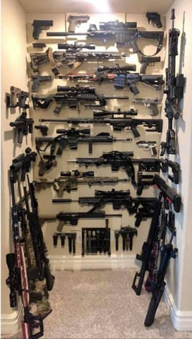 Picture of a collection of Spartan Mounts gun mounts and weapons accessory mounts. Over 50 rifle mounts, handgun mounts, and magazine mounts in total