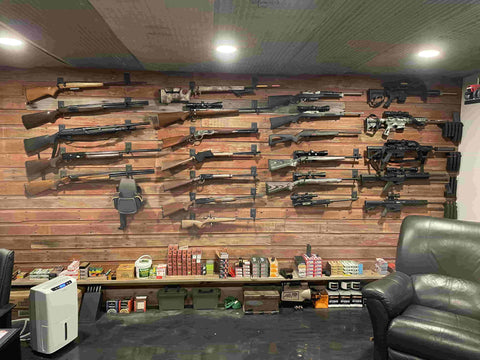 Large gun wall featuring rifle mounts and magazine mounts from Spartan Mounts. Total of 23 guns