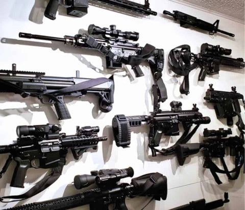 Picture of a very populated gun wall with Spartan Mounts, including rifles, handguns, and magazines all held up by rifle mounts, handgun mounts, and magazine mounts from Spartan Mounts