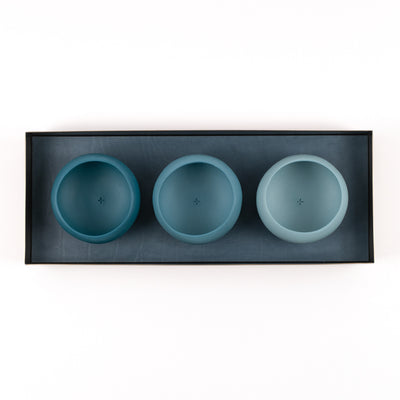 sea green porcelain copitas in a brass and leather tray
