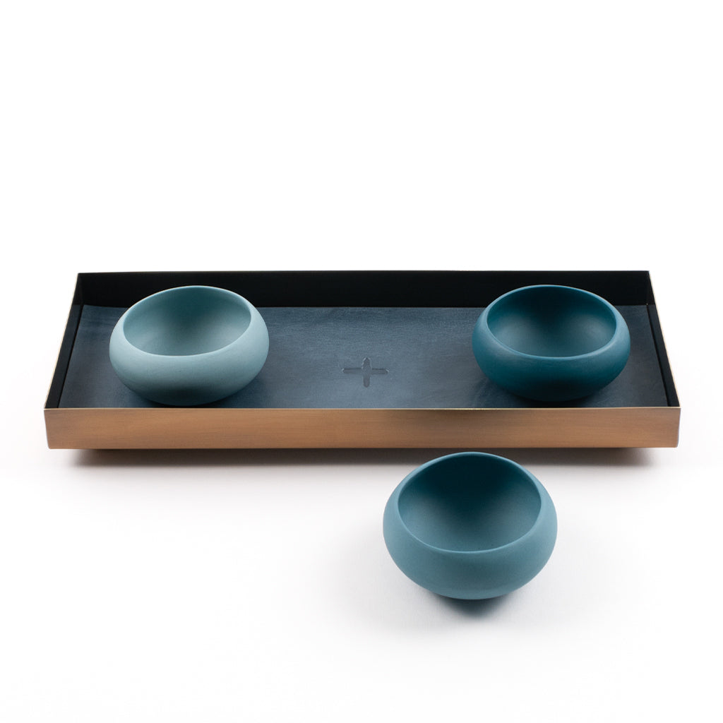 brass and leather tray with sea-green porcelain copitas