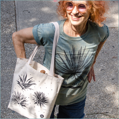 Natural canvas tote bags with six different agave plants printed with black ink on the front and back