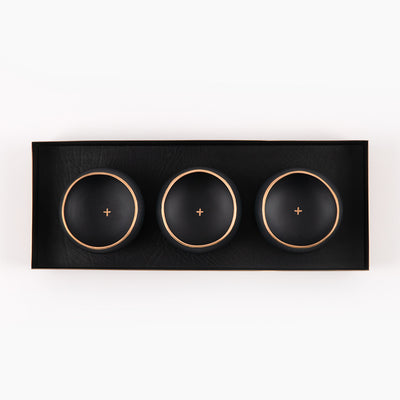 brass and black leather tray with black and gold porcelain copitas