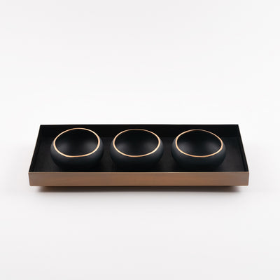 brass and black leather tray with porcelain copitas