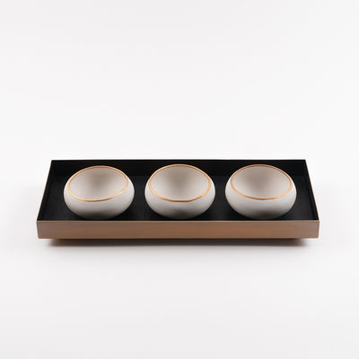 brass and black leather tray with three white and gold copitas for a flight of mezcal