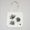 Detail of natural canvas tote bags with six different agave plants printed with black ink on the front and back