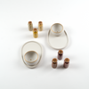 Mezcal gift set featuring two white and gold porcelain paring plates with copitas and six tasting salts
