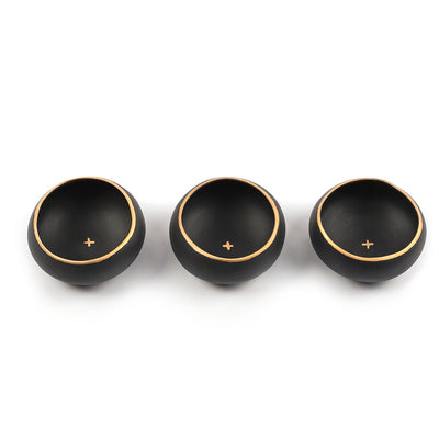 Set of three black and gold copitas for drinking mezcal