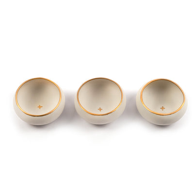 Set of three white and gold copitas for drinking mezcal