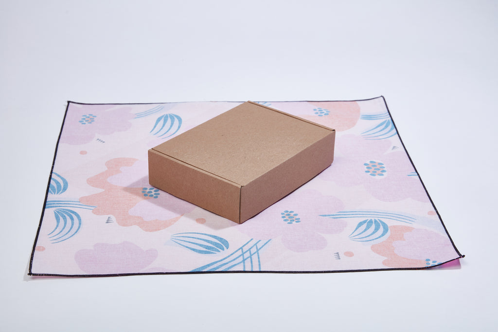 How to wrap a shipping box with eco-friendly gift wrap
