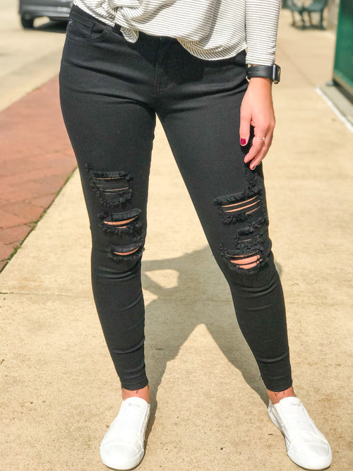 THE CECE MID RISE ANKLE DISTRESSED BLACK DENIM