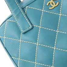CHANEL - Quilted Leather Handbag