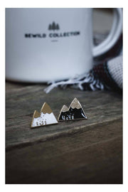 pins_metal_montagnes_noir_blanc_or