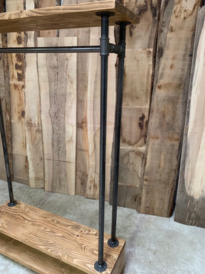 Industrial look clothes rails.