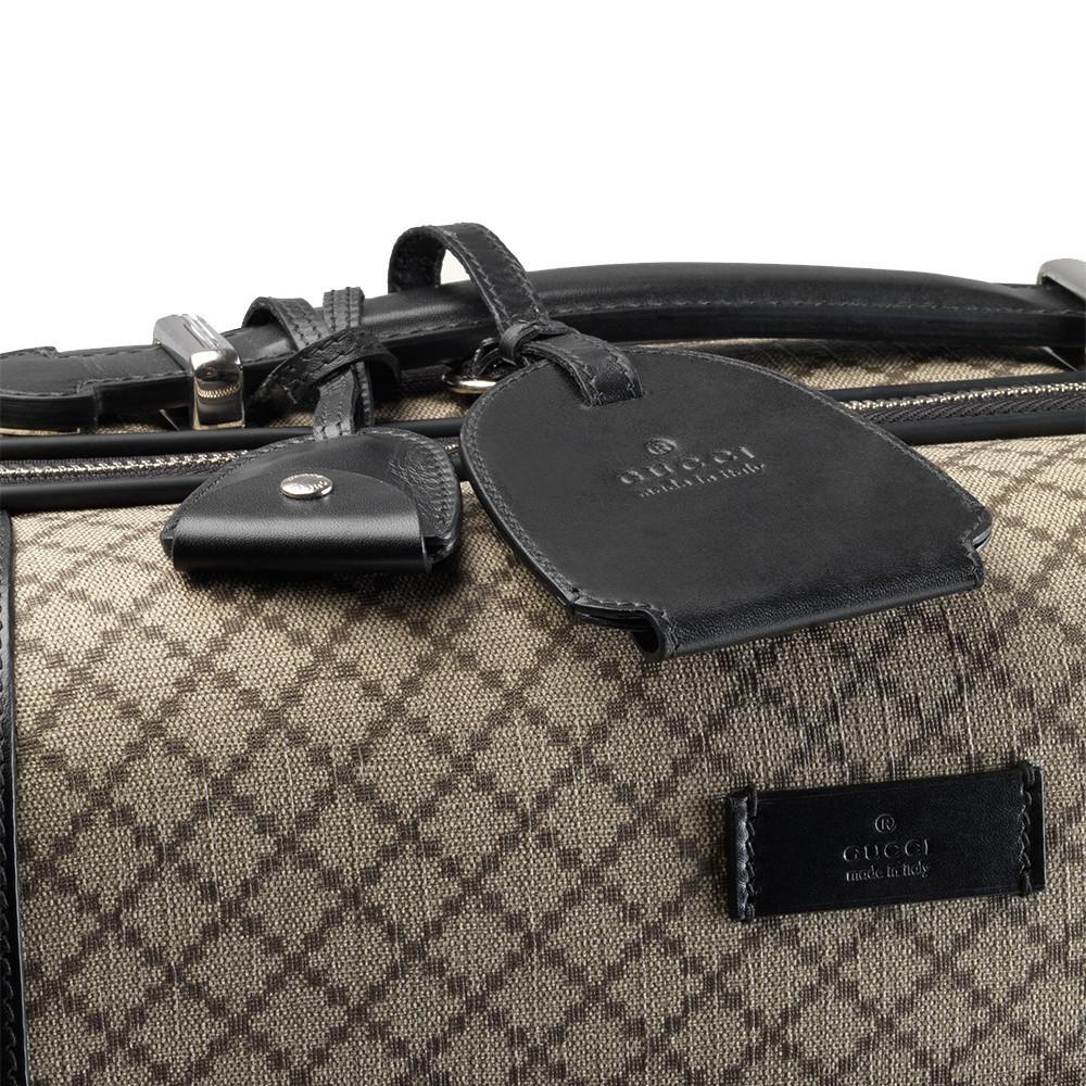 369837a693e ... Gucci Men s Black and Beige Supreme Canvas Carry-On Suitcase - Image  Candy