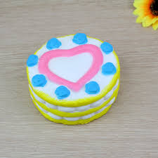 COLOSSAL HEART CAKE SQUISHY TOY