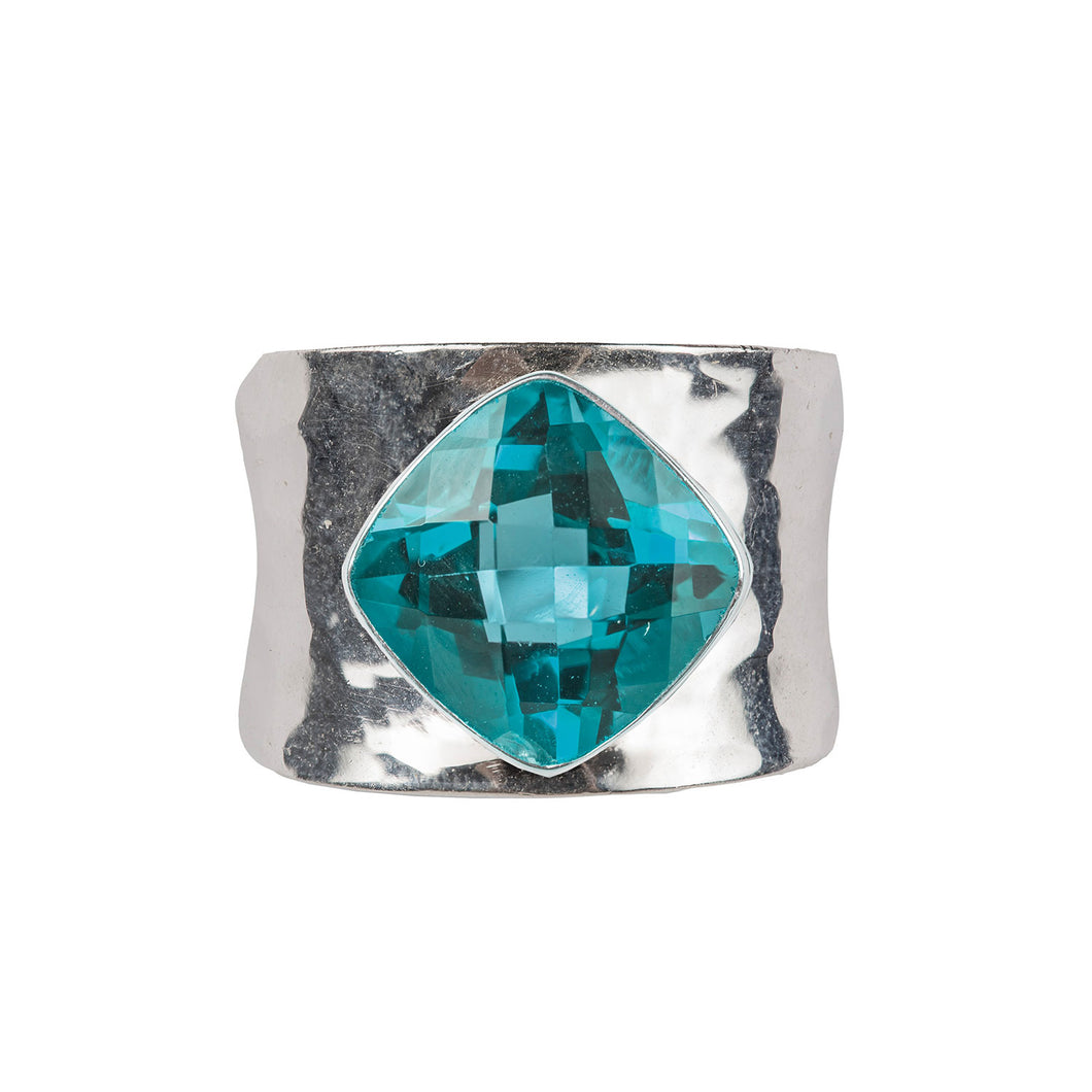 Contemporary beaten blue topaz ring