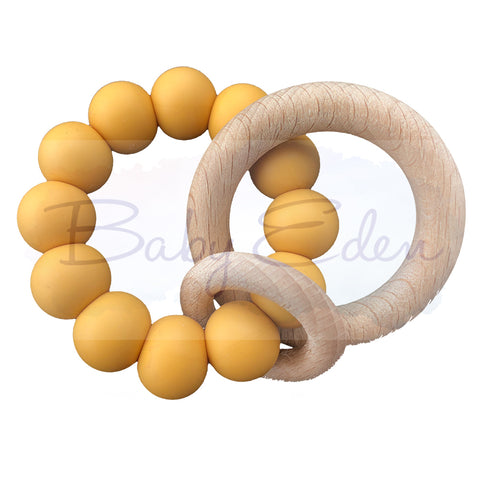 Mustard Silicone & Wood Small Rattle at Baby Eden
