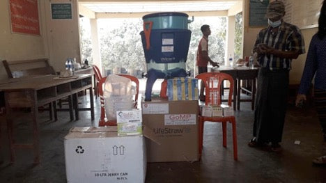 Unloading LifeStraw Supplies